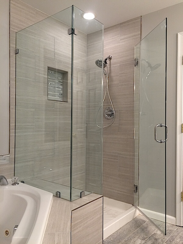 frameless corner shower enclosure over knee wall, installed with clips