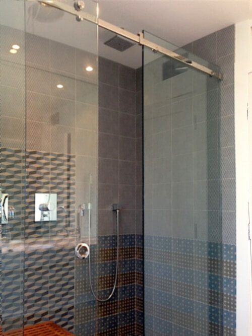 frameless corner sliding shower glass enclosure with one movable panel in the middle and fixed panels on each side