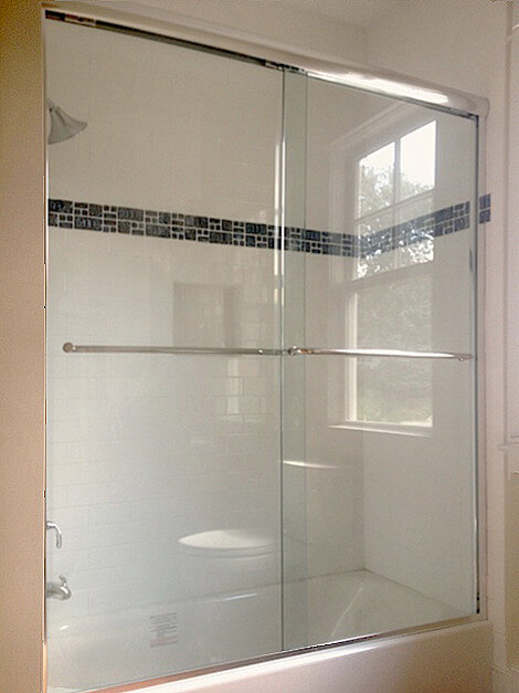 semi-frameless shower glass door enclosure for a tub